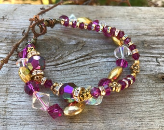 Ladies size 8 inch swarovski Raspberry and Clear crystal twist Bracelet.14k gold filed beads. one of a kind. RARE vintage crystal beads.