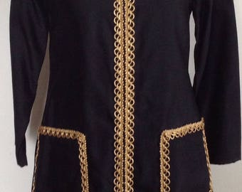 Metallic trimmed black long sleeved dress
