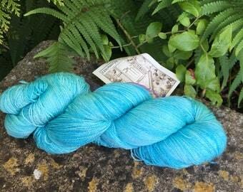 "95 gms hand painted merino /silk lace weight yarn."" Aqua seas"