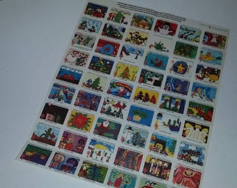 Vintage Easter Seals Christmas stamps sheet of 52 from 1980 color  paper supplies scrapbook altered art mixed media