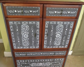 Bespoke wooden cabinet with drawers hand painted with stencilled Asian design