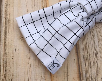 Black and white Grid organic cotton fabric gathered in the front, with a cinch bow in the back- The Best Headband you will ever own!