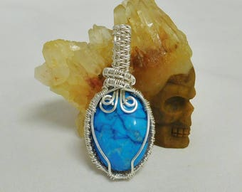 Blue and white magnesite two-sided oval wire wrapped pendant