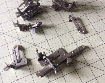 Vintage sewing machine attachments
