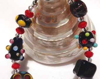 Artist made & designed lampwork bead bracelet of black glass beads with funky coloured dots.