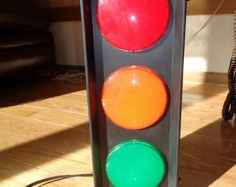 RED LIGHT, GREEN Light!  Faux  Stoplight Lamp that flashes intermittently and can be placed on a wall or on a table, A Conversation piece