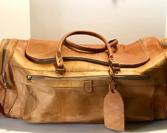 Vintage Leather Duffle Bag Soft Sided Luggage Huge Real Saddle Tan Worn Patina Brass Zipper grommets Made in Paraguay Gorgeous Designer Look