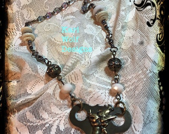Clock Key,  Bird, Necklace, Antique, Repurposed, Assemblage, Rosary Beads, Vintage Buttons, One of a kind. Created By: Kari Wolf Designs