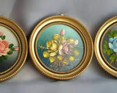 Lovely trio of round floral paintings