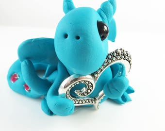 Polymer clay blue dragon with a heart