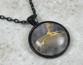 Kintsugi (kintsukuroi) inspired rose quartz stone pendant with gold repair in black bezel setting on black cable chain - OOAK