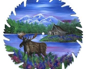 Hand Painted Saw Blade Mountain Summer Log Cabin and Moose