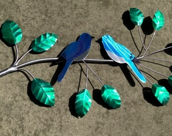 Metal Bluebirds sitting on a branch wall hanging