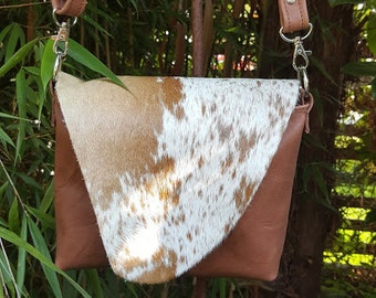 "KUHIE®, brown leather and cow fur bag ""Minnie"" from Brown and white cowhide"
