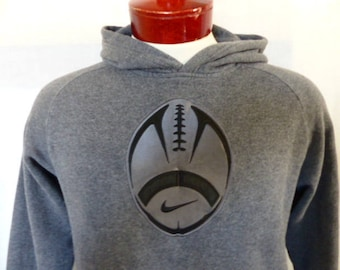 vintage 90's Nike Football charcoal gray fleece hoodie graphic sweatshirt raglan applique embroidered black swoosh logo youth XL adult small