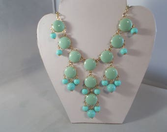 Bib Necklace with Turquoise and Blue Bead Pendants in Gold Tone Bead Frames on a Gold Tone Chain