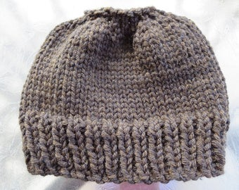 Hand knit woman's chocolate brown 100% wool pony tail or messy bun hat