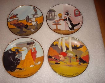 "Four Different Collectible Warner Brothers Looney Tunes 6.25"" Porcelain Plates (SOLD SEPERATELY)"