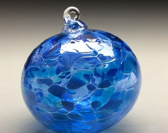 hand made blown glass Christmas ornament in tones of blue, pristine