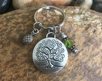 Silver Tree of Life Keychain with a peridot crystal and a pineapple charm