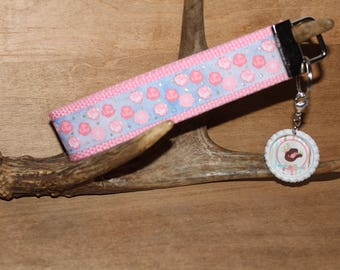"""Rustic Charm, Country Roses ribbon webbing key chain.  Bottle cap charm included, """"A little Rustic Country Charm"""" quote key chains/key fobs."""