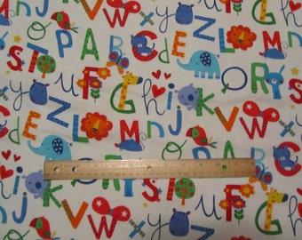 White with Multicolor Animals/ABC's Flannel Fabric  by the Yard