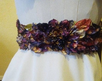Bridal belt made with petals flowers and fresh leaves
