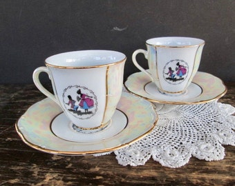 Set of Two Colonial Couple Designed Tea Cups with Saucers
