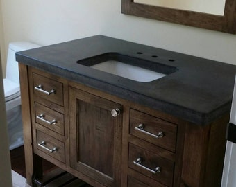Natural walnut vanity with concrete top