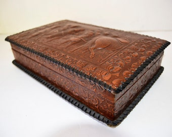 Cigarette music box made of wood lined with embossed leather paper