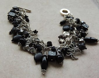 Goth black and silver charm bracelet bat/skulls/cross