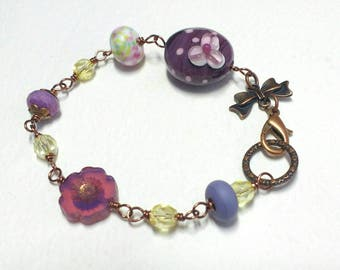 Blossom flower bracelet, wire wrapped lampwork.