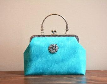 Beautiful light green kisslock purse with handle / crossbody bag