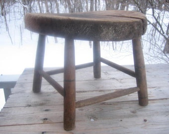 Small rustic milking bench