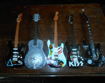 """Collectible Rock and Roll Mini Guitars - 10"""", Real Strings and Comes with Stand"""