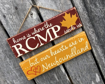 Home is Where the RCMP sends us hand painted sign