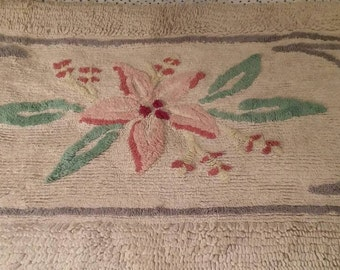 Chenille Area rug. 37 1/2 x 21.  Pink flower with green leaves.