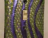 Dragon Scales. Green and Purple. Decorative Light Switch Cover. A Splash of Happiness at Your Fingertips. Let your imagination Light Up. LOL