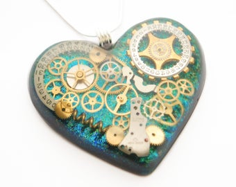 Steampunk Heart Pendant / Necklace, Watch Parts , Gears, Cogs in Resin, Iridescent  Blue Green, Sterling Silver Chain