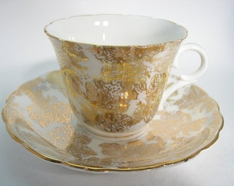 Colclough  Tea Cup and Saucer,  White and Gold tea cup and saucer set, Gold Filigree tea cup and saucer.