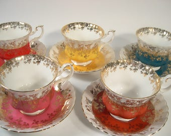 4 Royal Albert Tea Cups And Saucers, Regal Series Yellow,  Red, Pink and Teal with gold filigree tea cups and saucers.