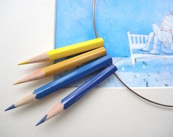 Wooden necklace with blue and yellow pencils