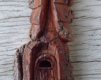 Handcarved cottonwood bark church in the hills
