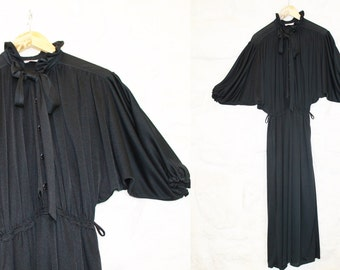 Vintage 80s black dress. Size M-L. Smart dress. Polyester. Buttons at the front.