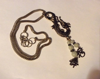Dragon pendant with beaded tassel necklace.  Lovely snake chain and oriental symbol accents.  Great pendant perfect for any outfit.