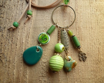 happy green face charm necklace