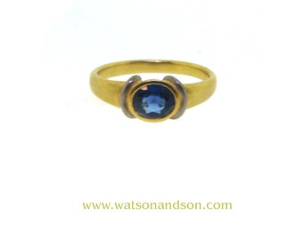 Faceted Oval Sapphire Ring in 18k yellow gold and platinum