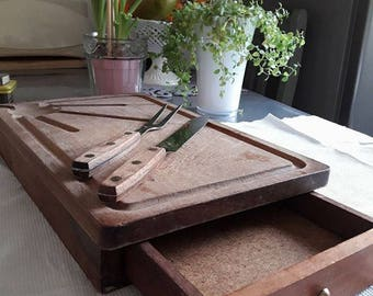 Old cutting board with vintage wooden drawer