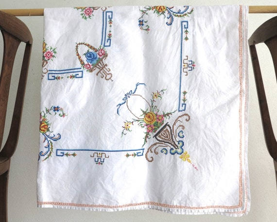 Mid century hand embroidered square tablecloth with cross stitched baskets and urns of flowers, orange faggoted edging, 48.5 ins / 124 cm