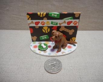 Miniature scene - dog with a bone